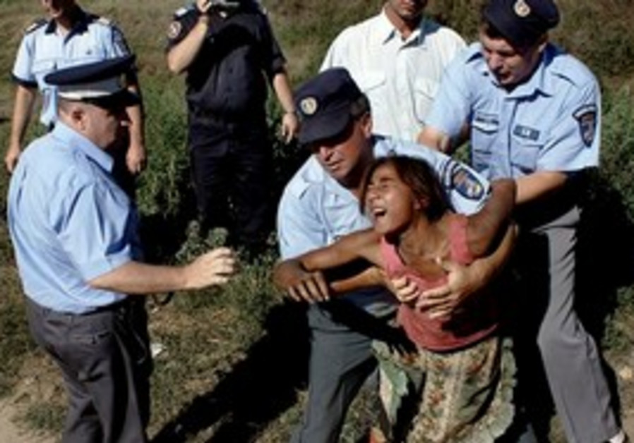 A Romanian Gypsy woman being deported.