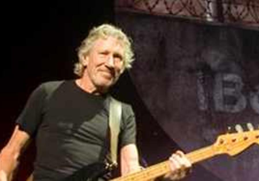 Roger Waters performing.
