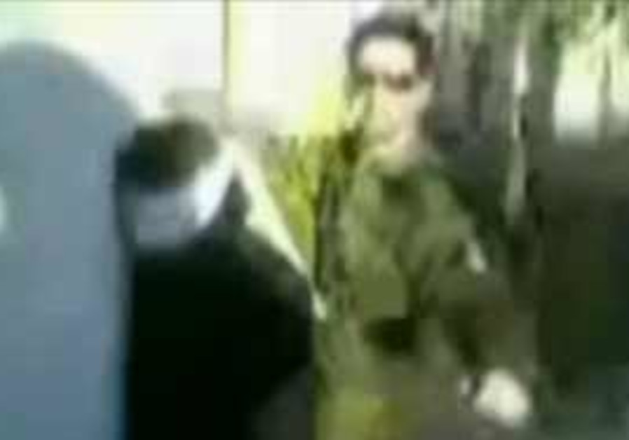 IDF soldier dancing with blindfold detainee