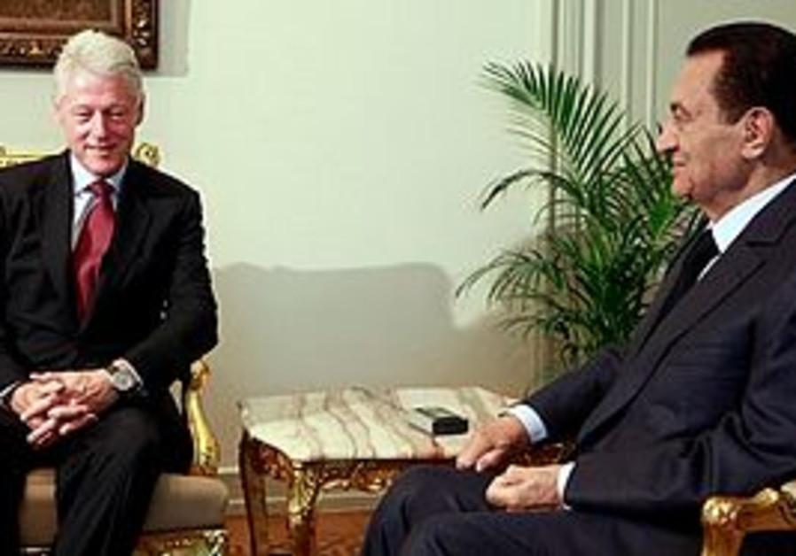 Bill Clinton and Hosni Mubarak