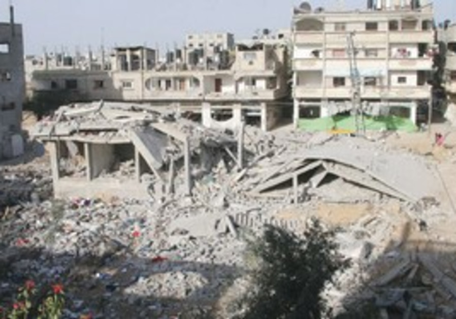 THE RUINS of a mosque and neighboring apartment bu