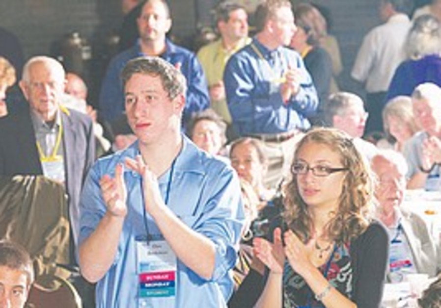 STUDENTS APPLAUD a speaker at CAMERA's two-day co
