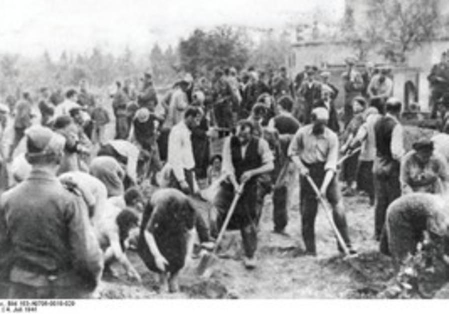 Jews digging own graves. Storow, Ukraine, 7/4/1941