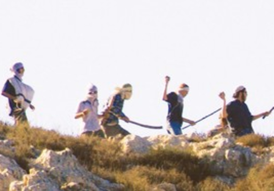 Settlers throwing rocks at Palestinians.