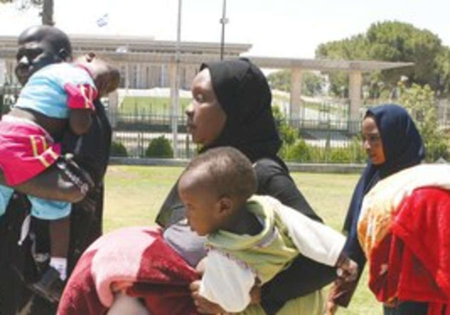 A family of African migrants outside the Knesset (file)