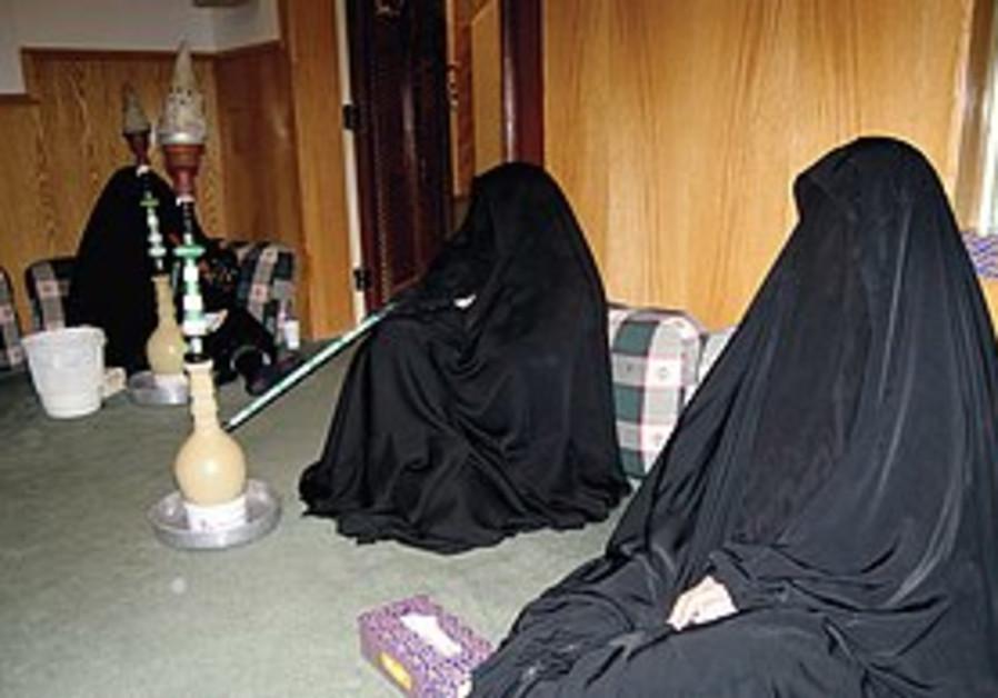 Saudi Women smoke water pipes.