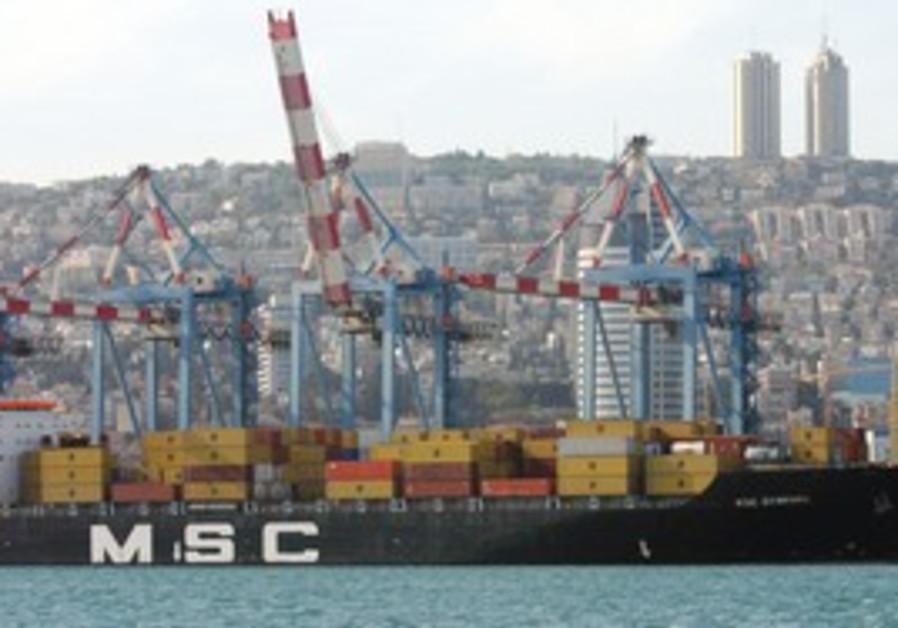 A ship unloads in the port of Haifa