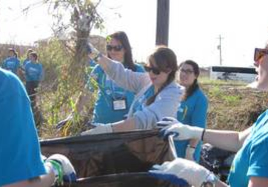 GA Day of Service volunteers clear overgrowth in t
