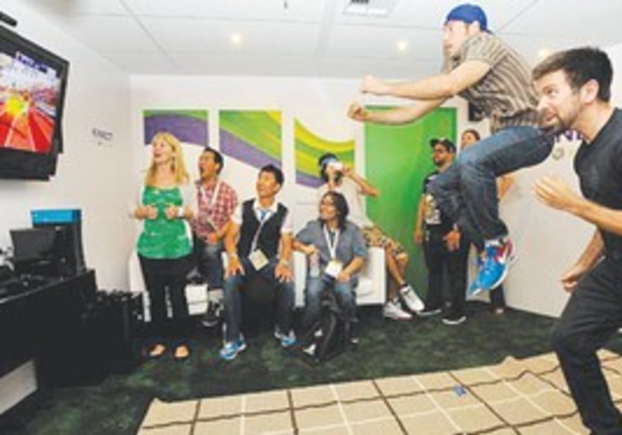 Gamers test out the new Microsoft Kinect device.