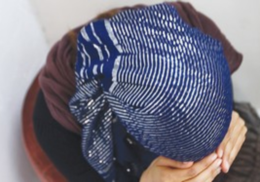 Illustrative photo of religious woman hiding face