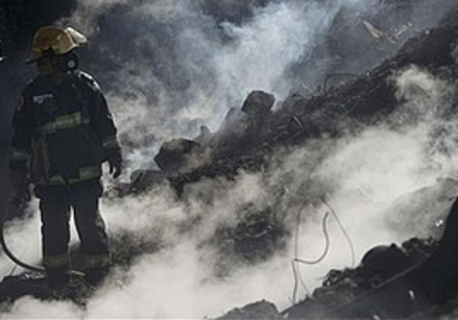 A firefighter near Yemin Orde, Sunday
