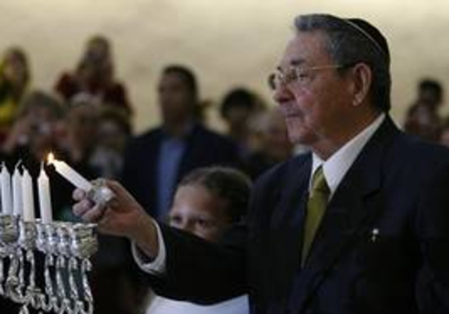Raul Castro lights first candle