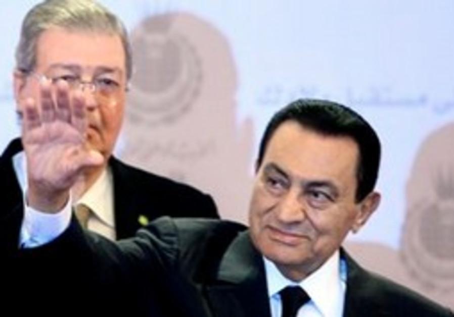 Egyptian President Hosni Mubarak waves