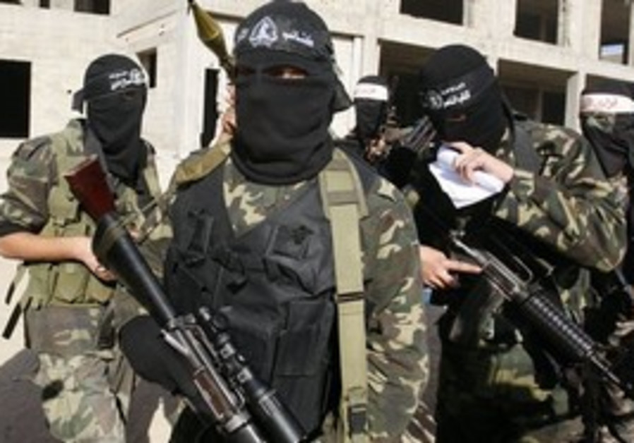 Masked Hamas men prepare for press conference