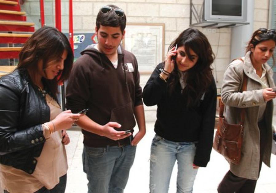 Cellphones may corrupt social development