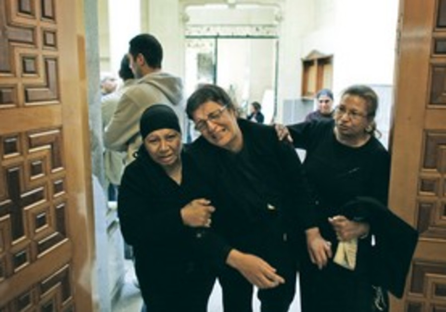 Grieving Egyptian Coptic Christians.