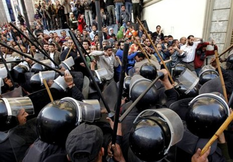 Angry protestor shouts at police in Cairo (AP)