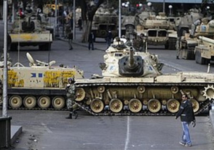 Military vehicles block a street in Cairo, Sunday