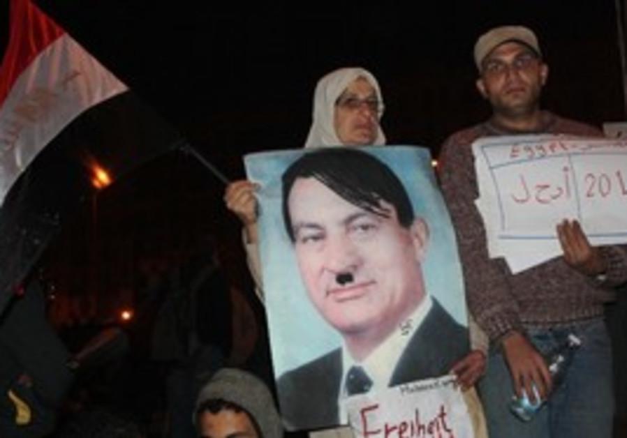 A sign of Egyptian President Mubarak as Hitler