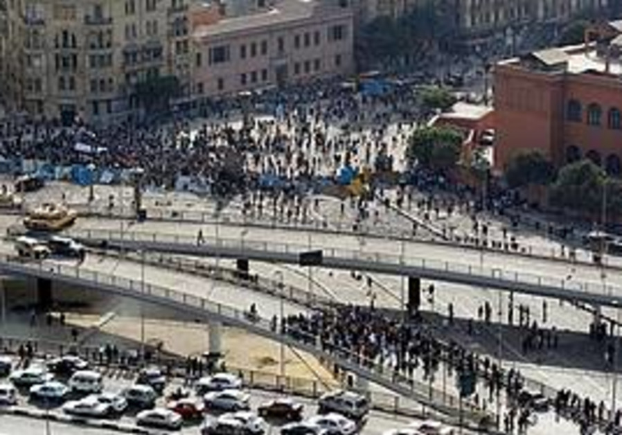 Protesters storm the October 6 bridge in Cairo