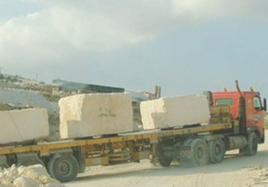 A truck leaves the quarry south of Bethlehem