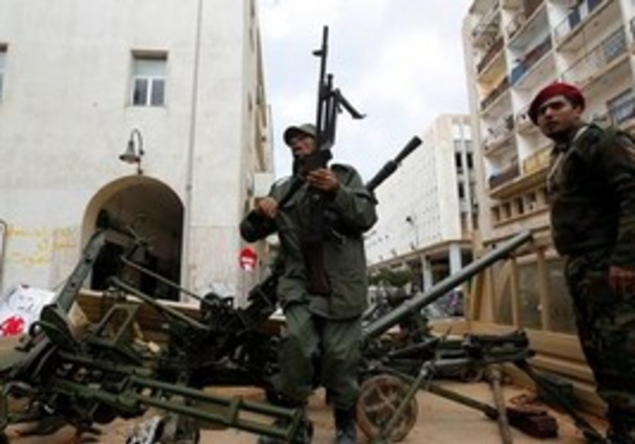 Anti-Gaddafi gunmen in Libya