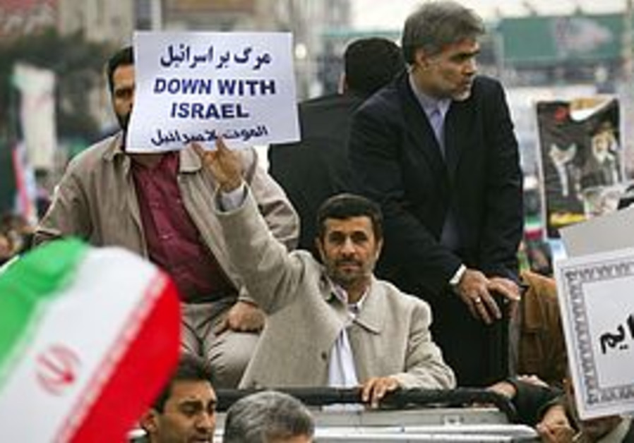 Ahmadinejad with sign, in Persian: Death to Israel