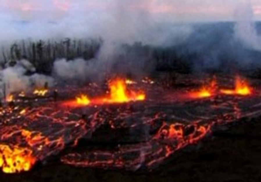 Lava spews from the active Mt. Kilauea volcano