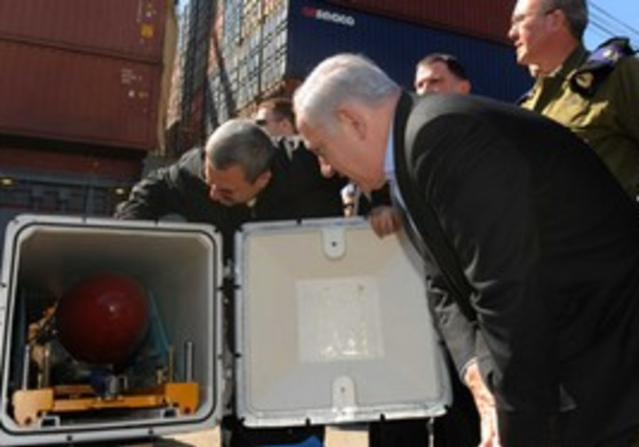 Netanyahu looks at a missile found on 'Victoria'