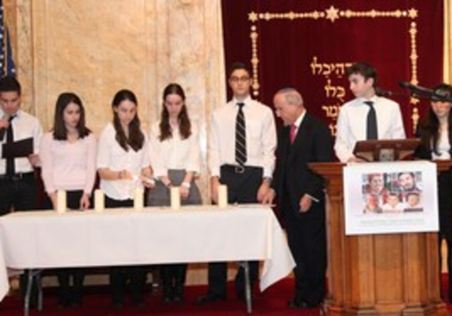 Rabbi Haskel Lookstein and students light candles