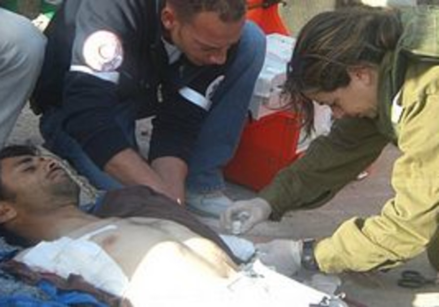 IDF and Red Crescent treat stabbing victim