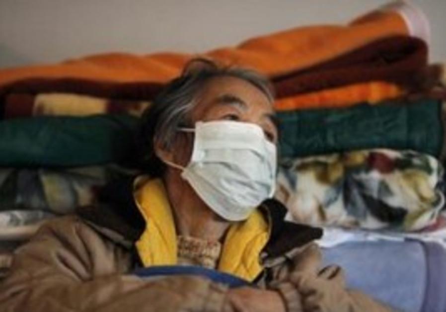 A refugee rests at relief centre in Minamisanriku