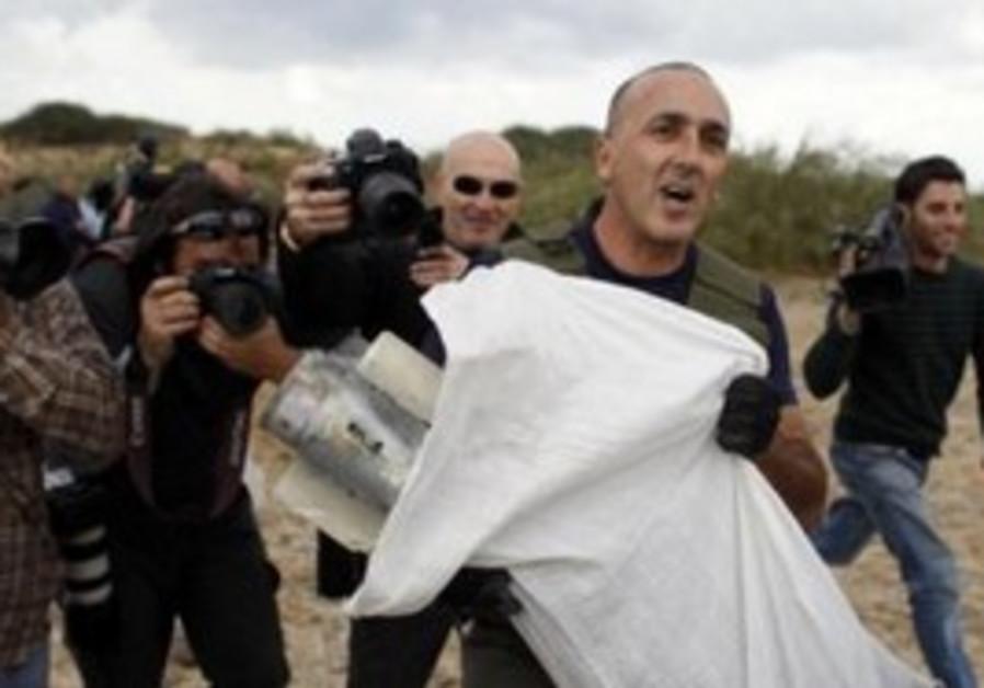 Police sapper carries a Grad rocket near Ashdod