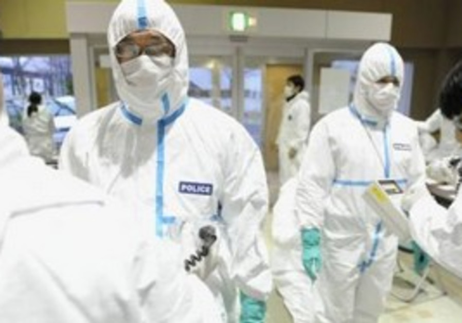 Japanese police after radiation screening