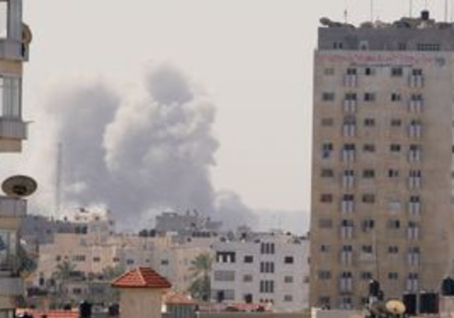 SMOKE RISES from a security compound in Gaza