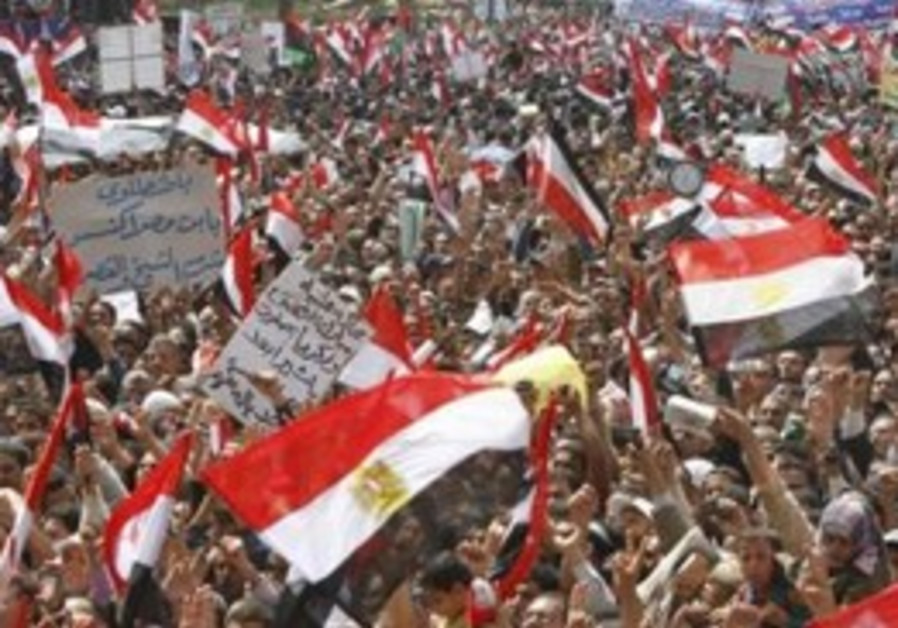 Protesters wave Egyptian flags during a protest