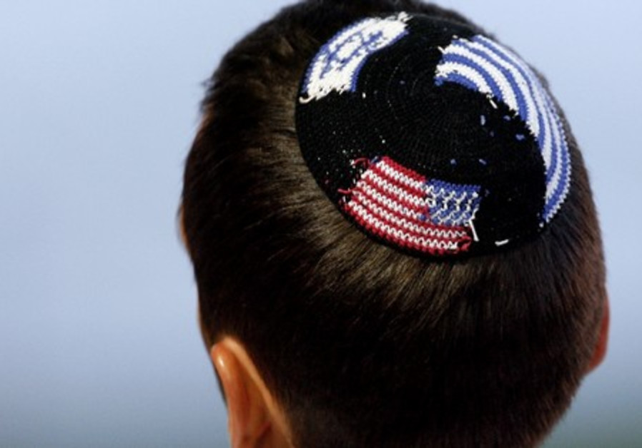 Boy wearing American and Israeli flags Kippa