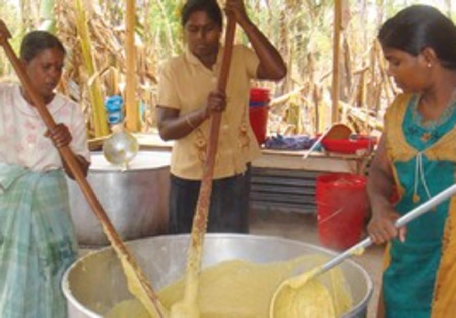 Sarvodaya women prepare food for victims