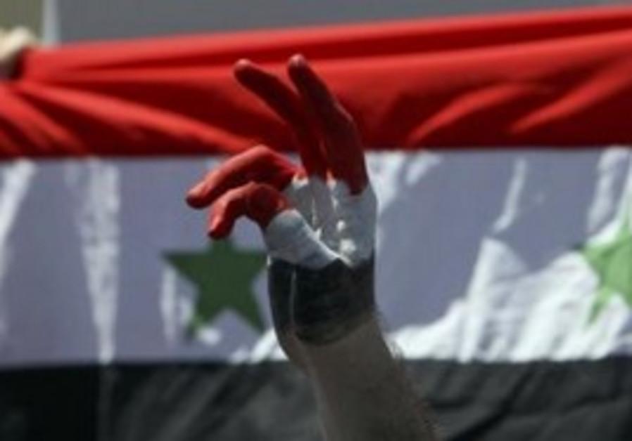 Syrian protester against flag