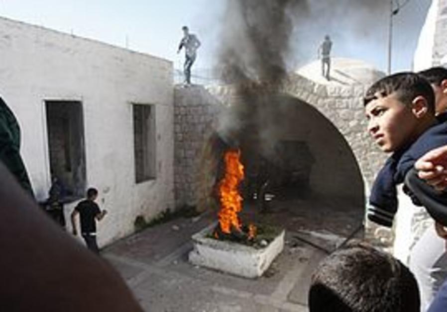 Palestinians burn tires at Joseph's tomb
