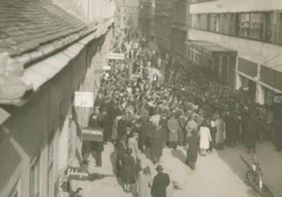 Jews wait outside the Glass House in Budapest.