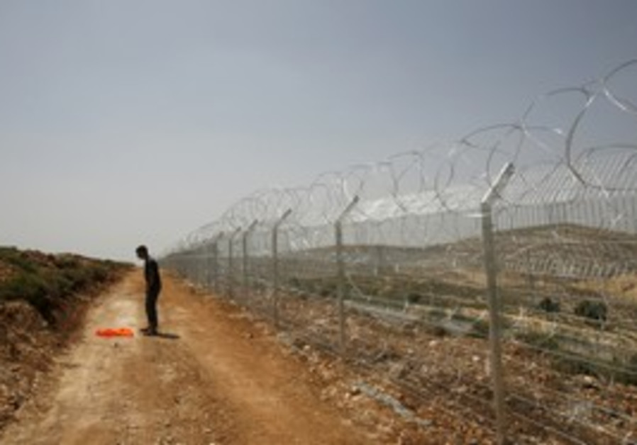 Security fence near Jerusalem [illustrative]