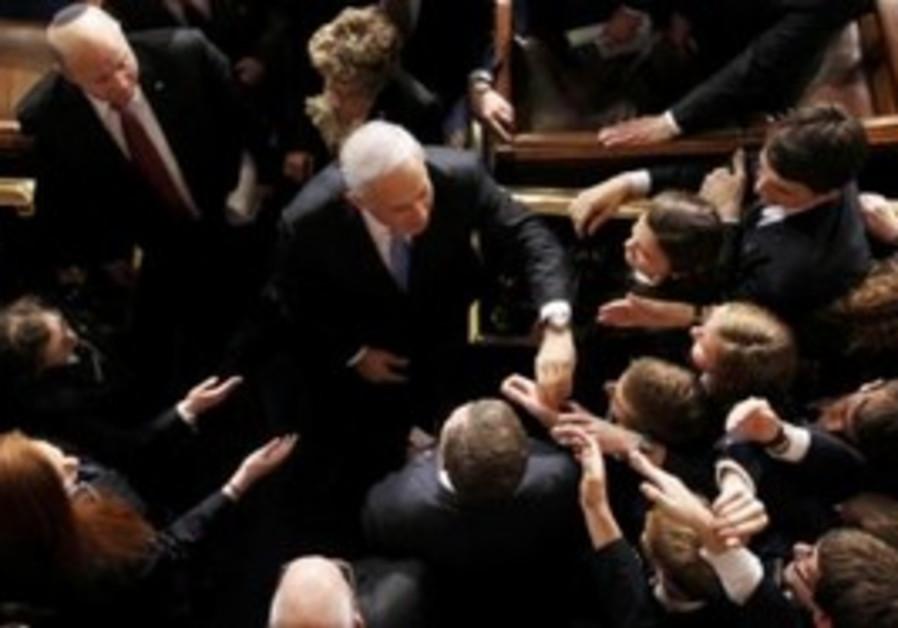 US Congresspeople shake hands with Netanyahu