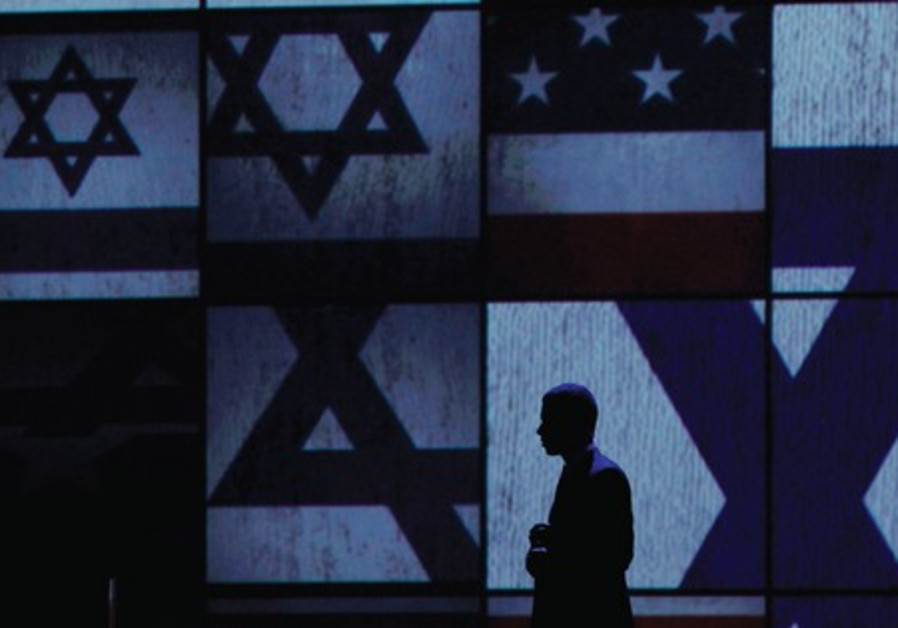 An Israeli official seen walking on AIPAC's stage.