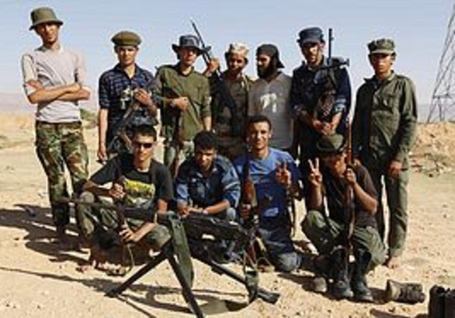 Libyan rebels pose for a photograph