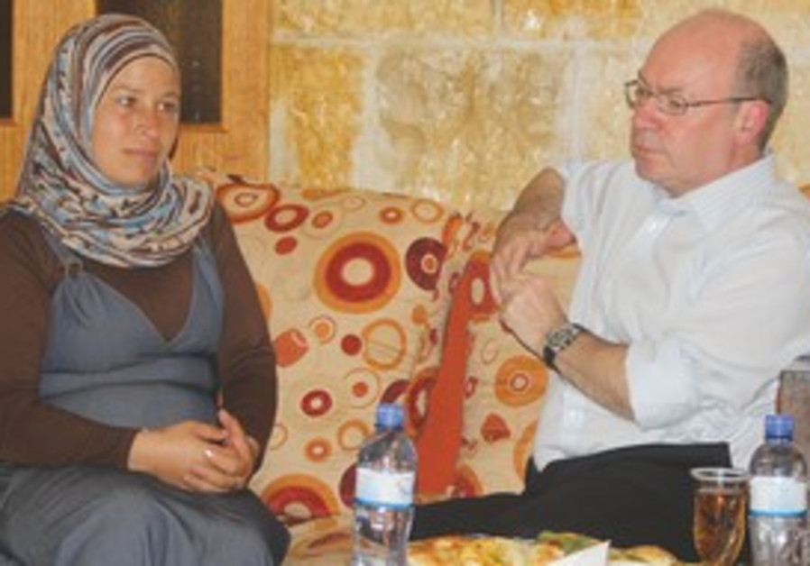 Alistair Burt speaks with wife of protest activist
