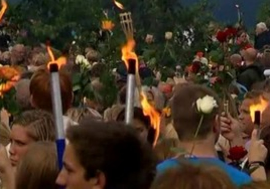 A thousand march in torch parade for victims