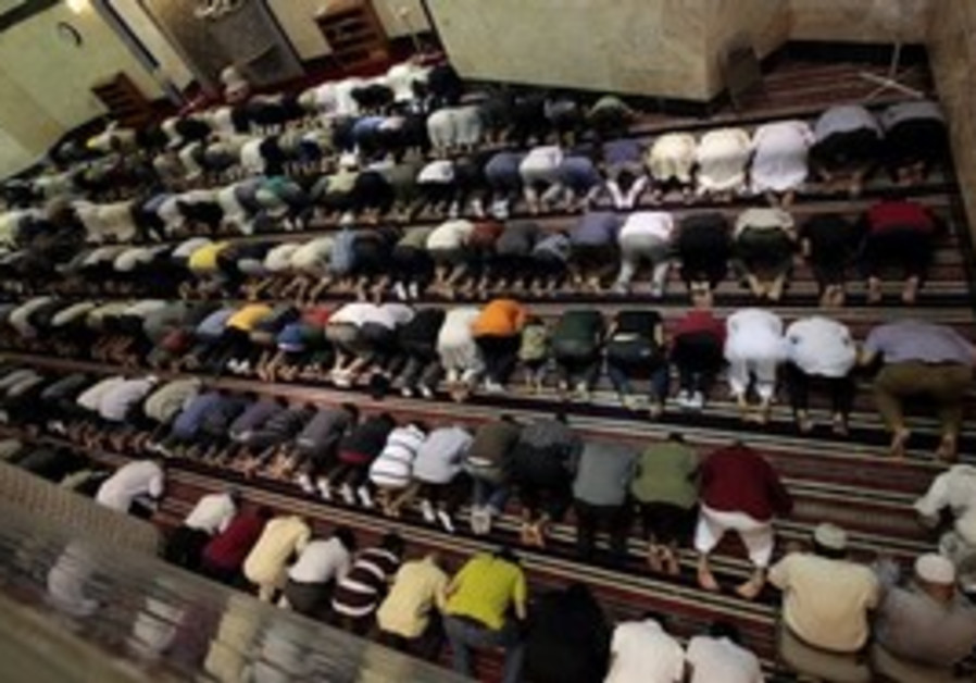 Muslims pray during Ramadan