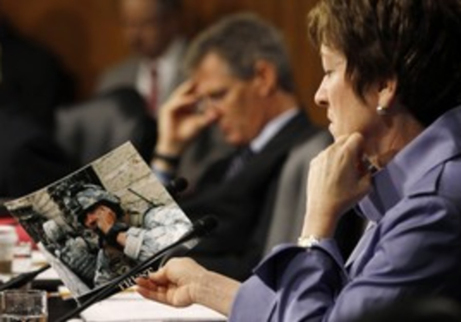 US Senator Susan Collins (R-ME) looks at soldier