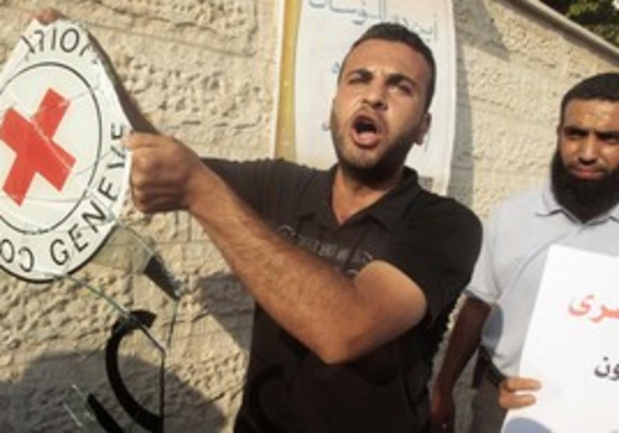 Palestinian holds IRC sign outside Hamas headquart